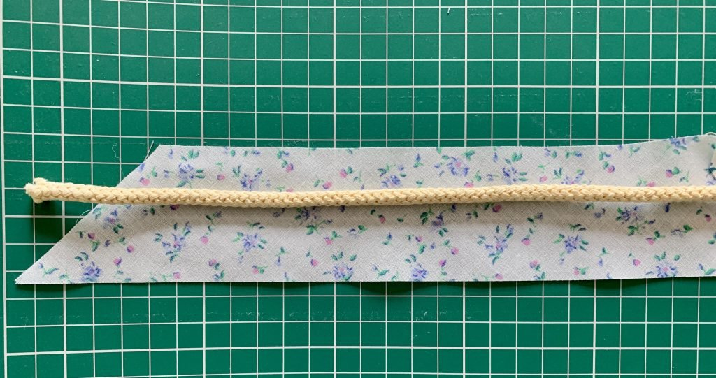 bias tape laid flat with cording running through the middle.