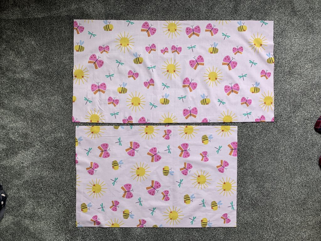 2 pieces of fabric on How To Sew A Pillowcase By Hand.